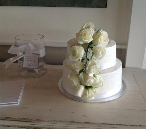 Small two tier wedding cake with white flowers
